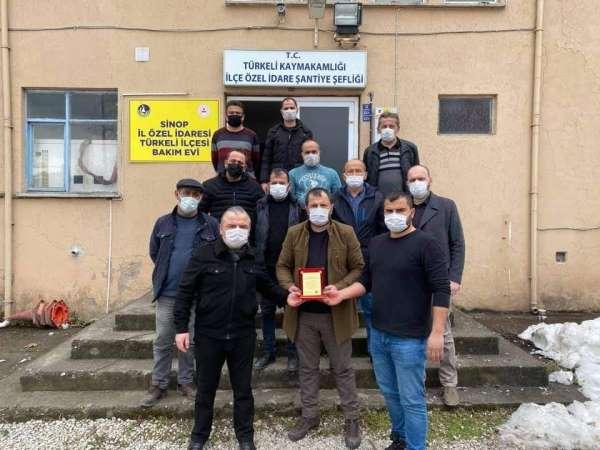 Türkeli MHPden emekçilere teşekkür plaketi