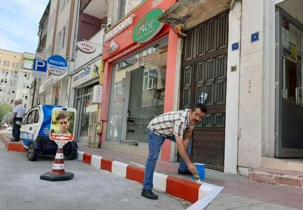 Esnaf kaldırımları Samsunspor rengine boyadı