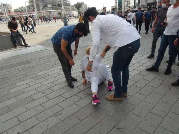(ÖZEL) Taksim'de 2 erkek şahıs, bir kadını tekme tokat darp etti