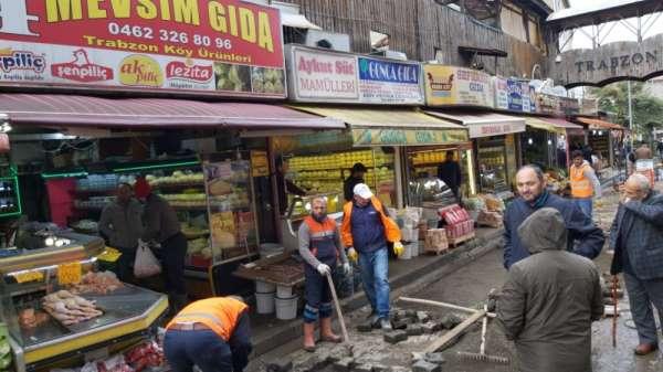 Trabzon'daki şiddetli yağışın ardından iş yerlerindeki ve sokaklardaki temizlik