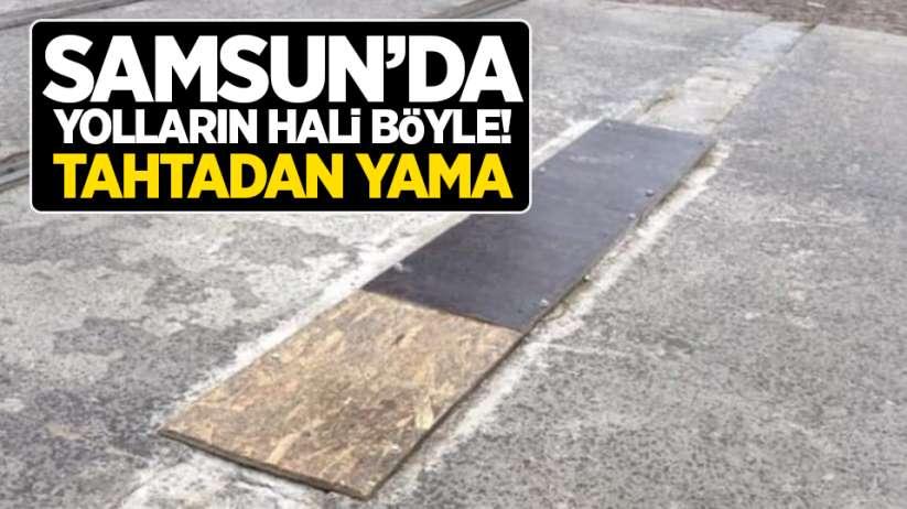 Samsun'da yolların hali böyle! Tahtadan yama