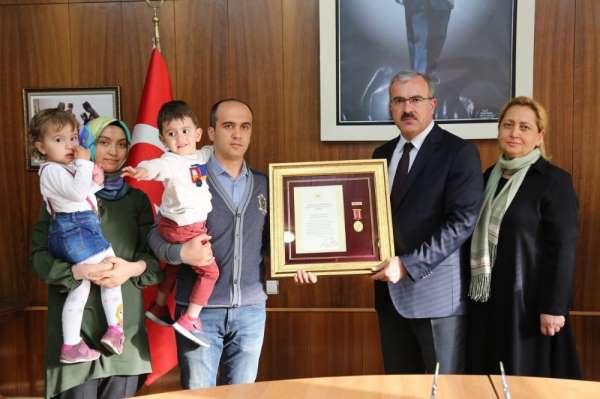 Kütahya'da şehit ve gazilere Devlet Övünç Madalyası verildi
