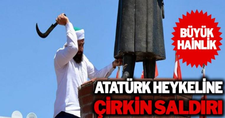 `Dinimizde putperestlik haram` deyip Atatürk heykeline saldırdı